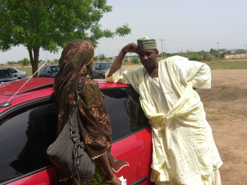 Singer Aminu Ala speaking with friend, novelist Sa'adatu Baba Fagge, before his court case on 7 July 2009, Airport Magistrate Court, Kano.